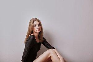 one teenage girl posing, sitting on