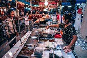 Women Frying Meat for Customer