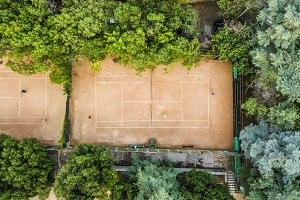 aerial sunny summer tennis courts to