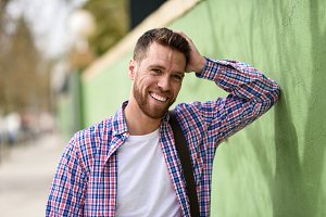 Attractive young man laughing outdoo