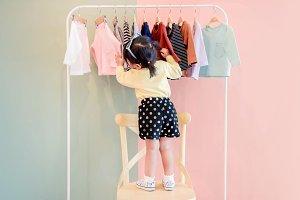 A Girl choosing own dress