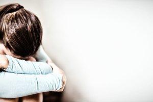 Sad schoolgirl sitting alone