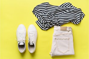 Female white sneakers and jeans