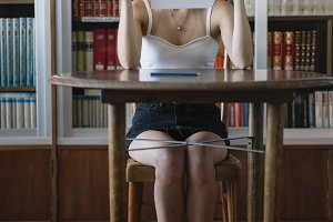 view of a young woman studying in th