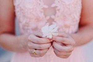 woman holding small flower