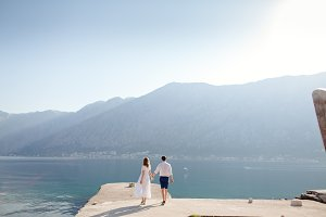 romantic couple travel sea bay and m