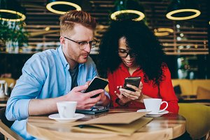 Couple using app on smartphones
