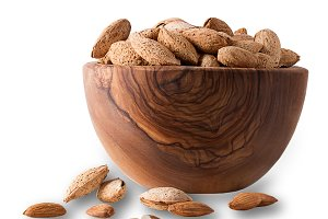 Almond in wooden bowl isolated on wh