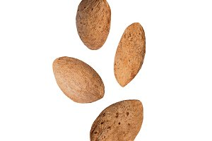 Falling almonds isolated on white ba