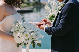 groom wearing wedding ring