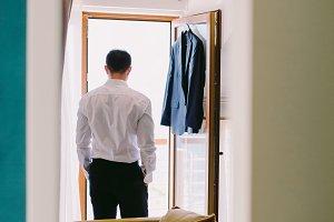 man getting dressed