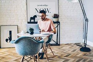 Male freelancer working on laptop