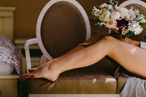 women legs and bouquet