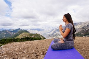 woman yoga practice in mountains