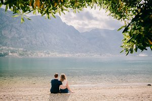 lovely couple relax on beach togethe