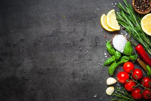 Food cooking background on black
