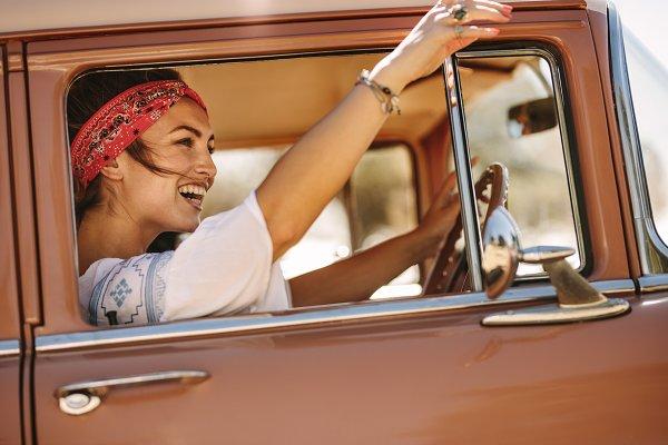 People Stock Photos: Jacob Lund Photography - Woman enjoying driving car