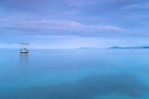Boat in adriatic sea at sunrise