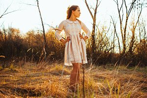 Beautiful girl standing in a field o