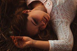 portrait of a girl lying on a field