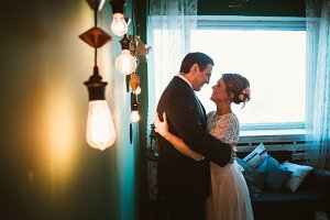 couple groom and bride in light stud