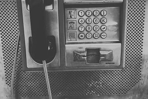 Vintage payphone black and white