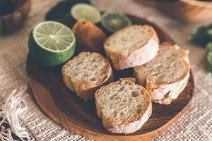 Sliced bread on wooden table with