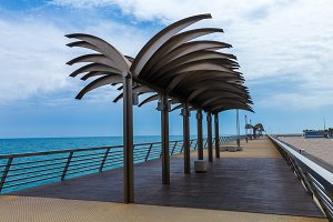 Pier with steel palms against the