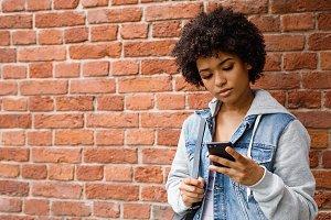 Teenage girl chatting on smartphone