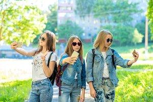 Three teenage girls. Summer in