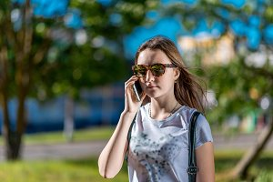 A teenage girl is talking on phone