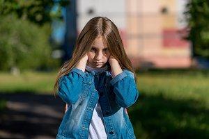 Little girl teenager. In summer city
