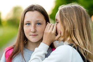 Two girls schoolgirl, in summer in a