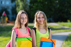Two young schoolgirls. Summer in