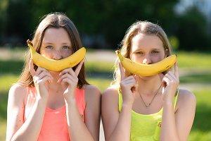 Two girls schoolgirl. In her hands