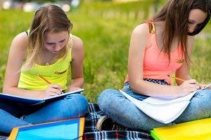 Two girls schoolgirl. Summer in