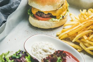 Beef burger, french fries, salad