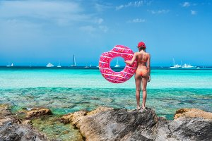 Woman with pink donut swim ring