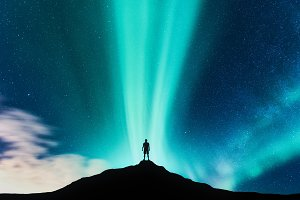 Northen lights and man on the hill