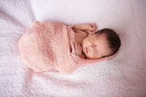 Newborn sleep in cloth wrap