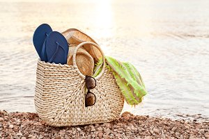 Straw Bag On The Shore