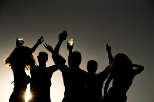Backlight of young people having fun
