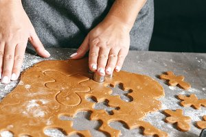 Woman cooking gingerbread cookies