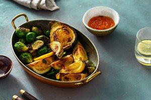 Fried broccoli zucchini served pan H
