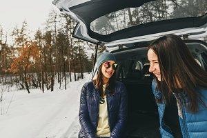 Friends having fun in winter forest