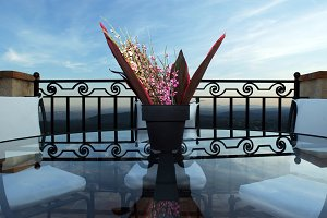 Table and Flowers with View of Ocean