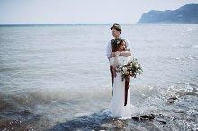 Amazing wedding couple into the sea