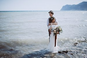 Amazing wedding couple into the sea
