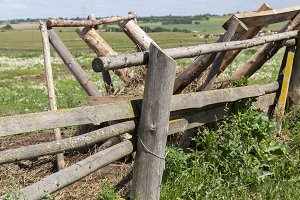 old fence and wooden feeders