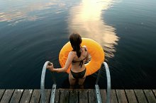Girl with water wheel ready to swim